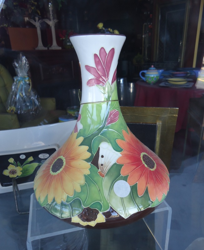 Vase in an out of business florist's window