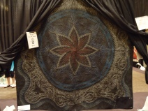 This is the back side. Heavy quilted with colored thread created the ghostly image of the design.