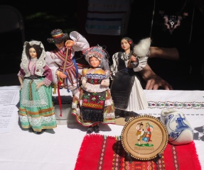 Ethnic costumed dolls grace the PIFD table.