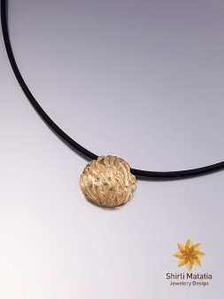 Gold nugget necklace.