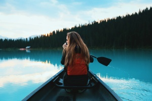 Woman paddling canoe