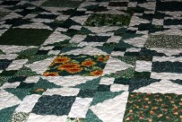 green-and-white-quilt-600x400
