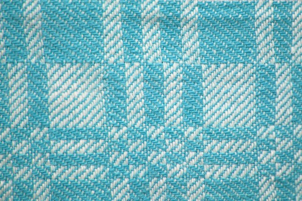 teal-and-white-woven-fabric-texture-with-squares-pattern-600x400