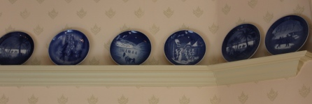 A collection of Danish Christmas plates line the dining room.