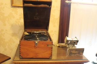 A phonograph, and a stereoscope viewer.