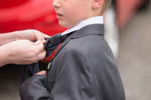 selective focus photography of boy in suit