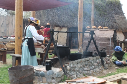 Cooking in cauldrons over a fire