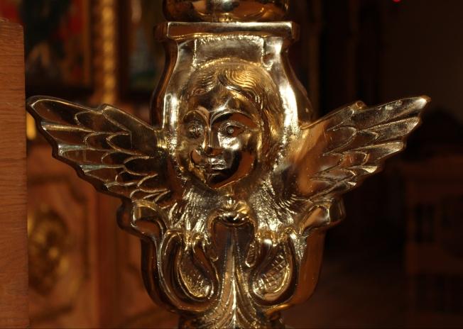 Monastery; angel candlestick