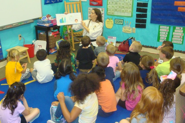 Jenifer Tull-Gauger reading to students